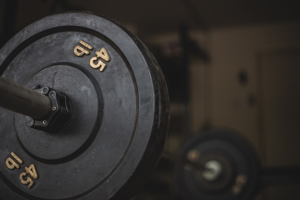 black and gray dumbbell on black surface