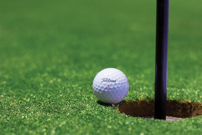 white golf ball on green grass field during daytime