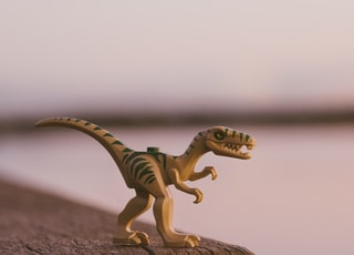 green and brown dinosaur toy