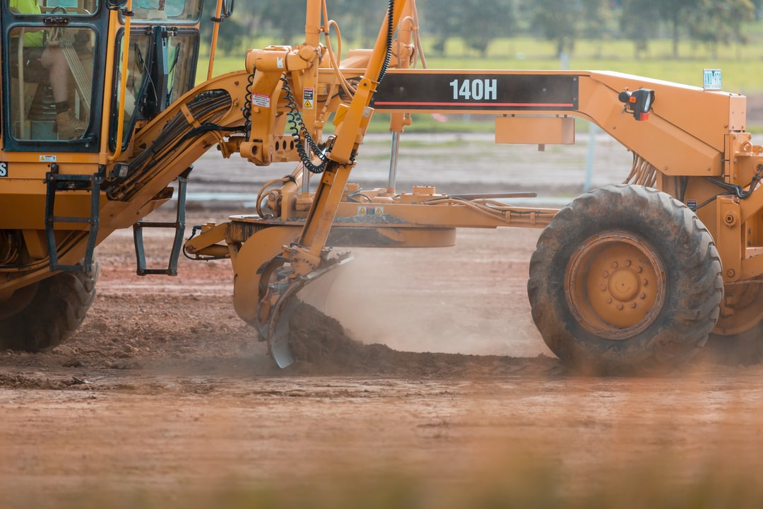 Grader Heavy Vehicle at work on residential estate construction site.
