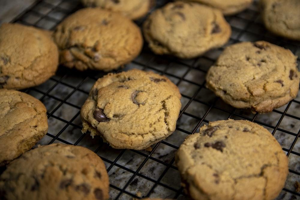 brown cookies on black metal grill
