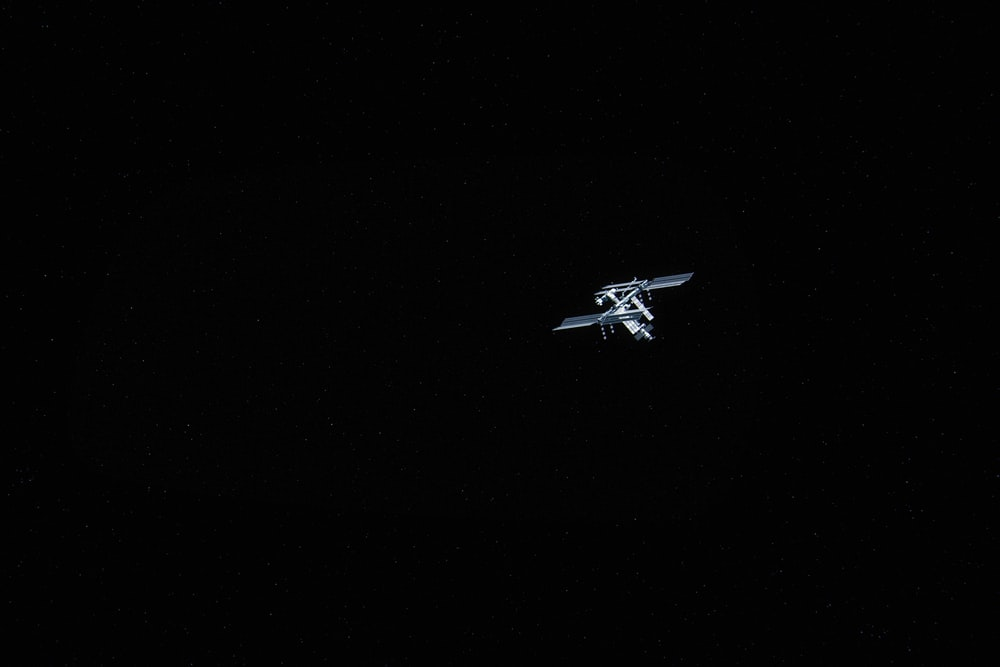 white and black airplane in the sky
