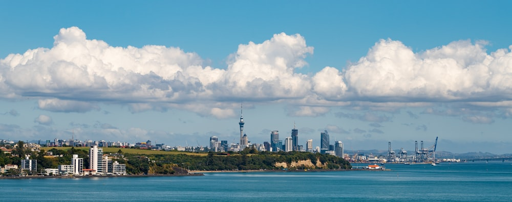 city skyline under blue sky and white clouds during daytime