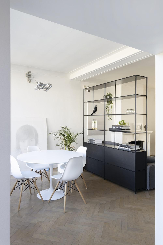 black wooden cabinet beside white table