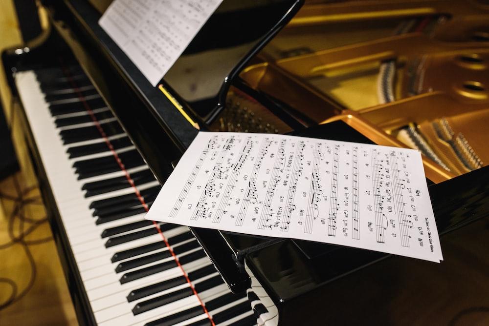 white paper on black piano