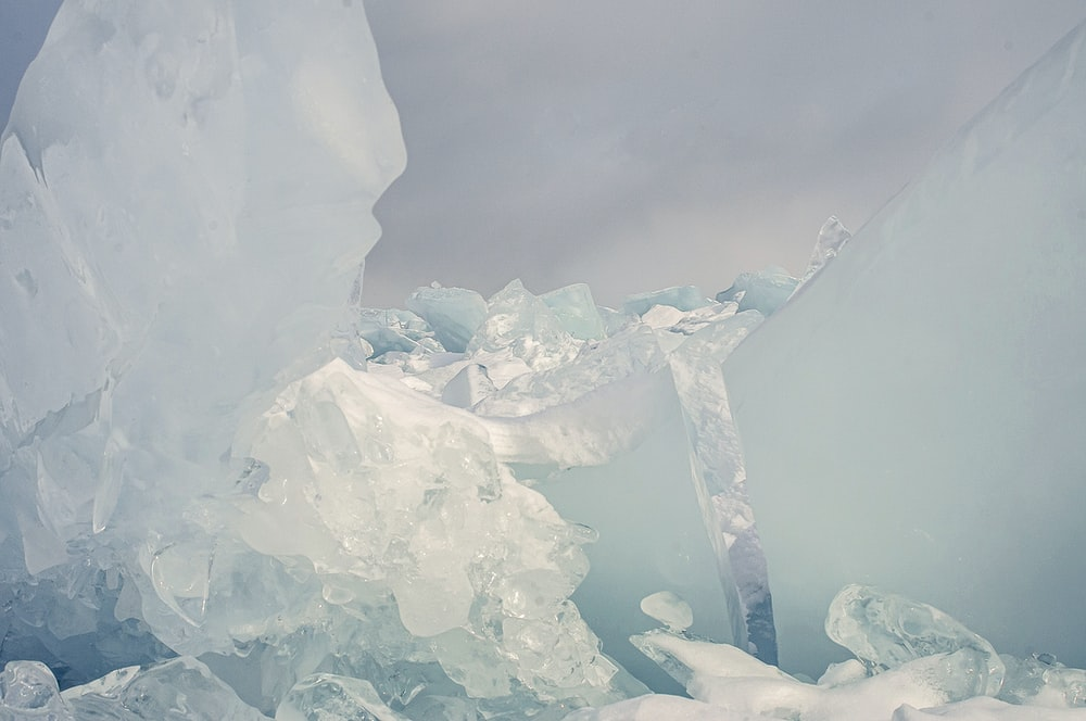white ice blocks on water