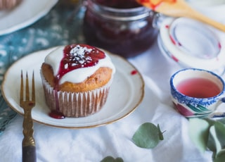 brown cupcake on white ceramic plate