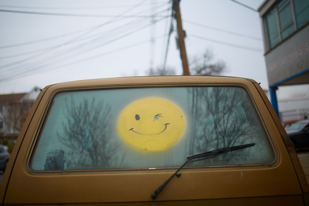 yellow and white car with yellow and black sun sticker