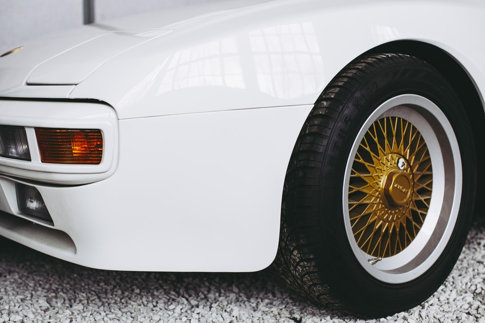 white car with brown wheel
