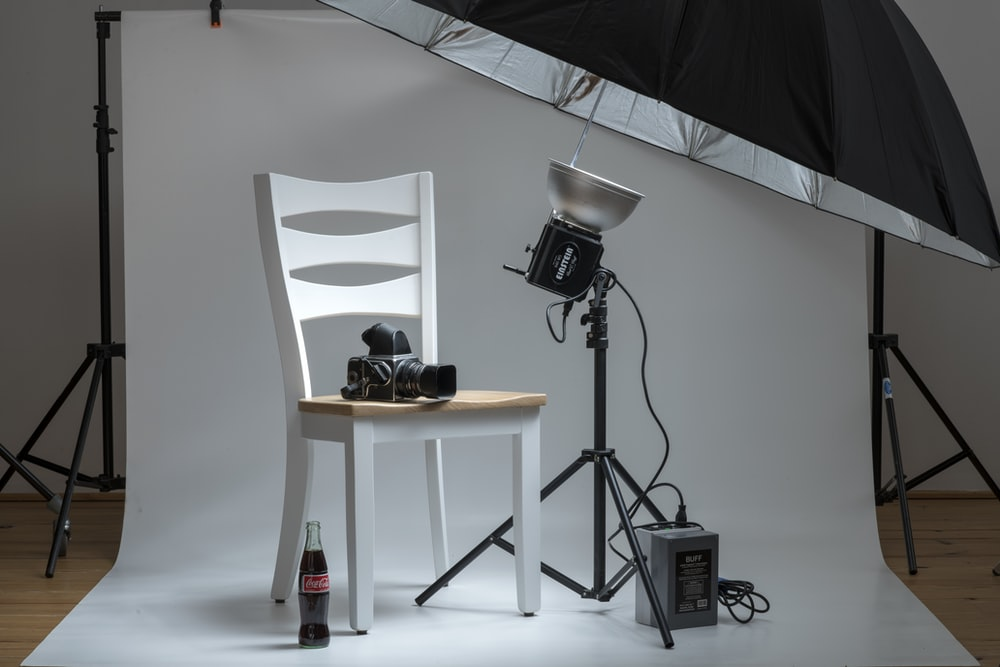 black and silver microphone on brown wooden table