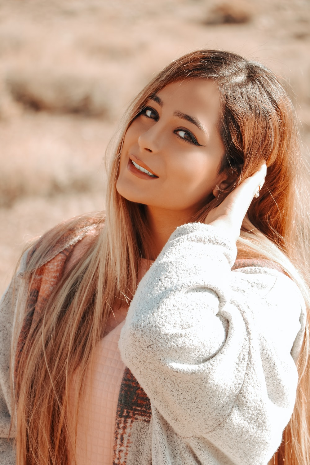 woman in white sweater smiling