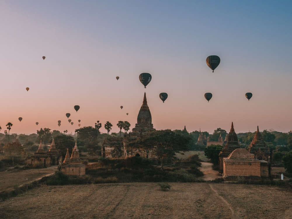 hot air balloons in the sky during sunset