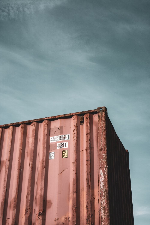 brown steel container van under blue sky during daytime