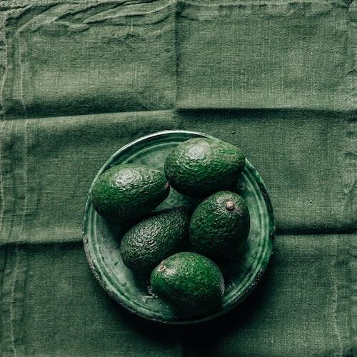 a bowl of avocados.