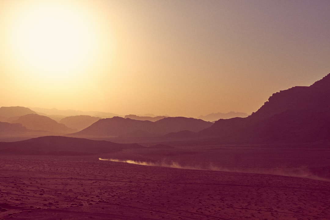 A hazy sunset in the desert of Wadi Rum. Could be a scene out of Mad Max? Definitely sci-fi.