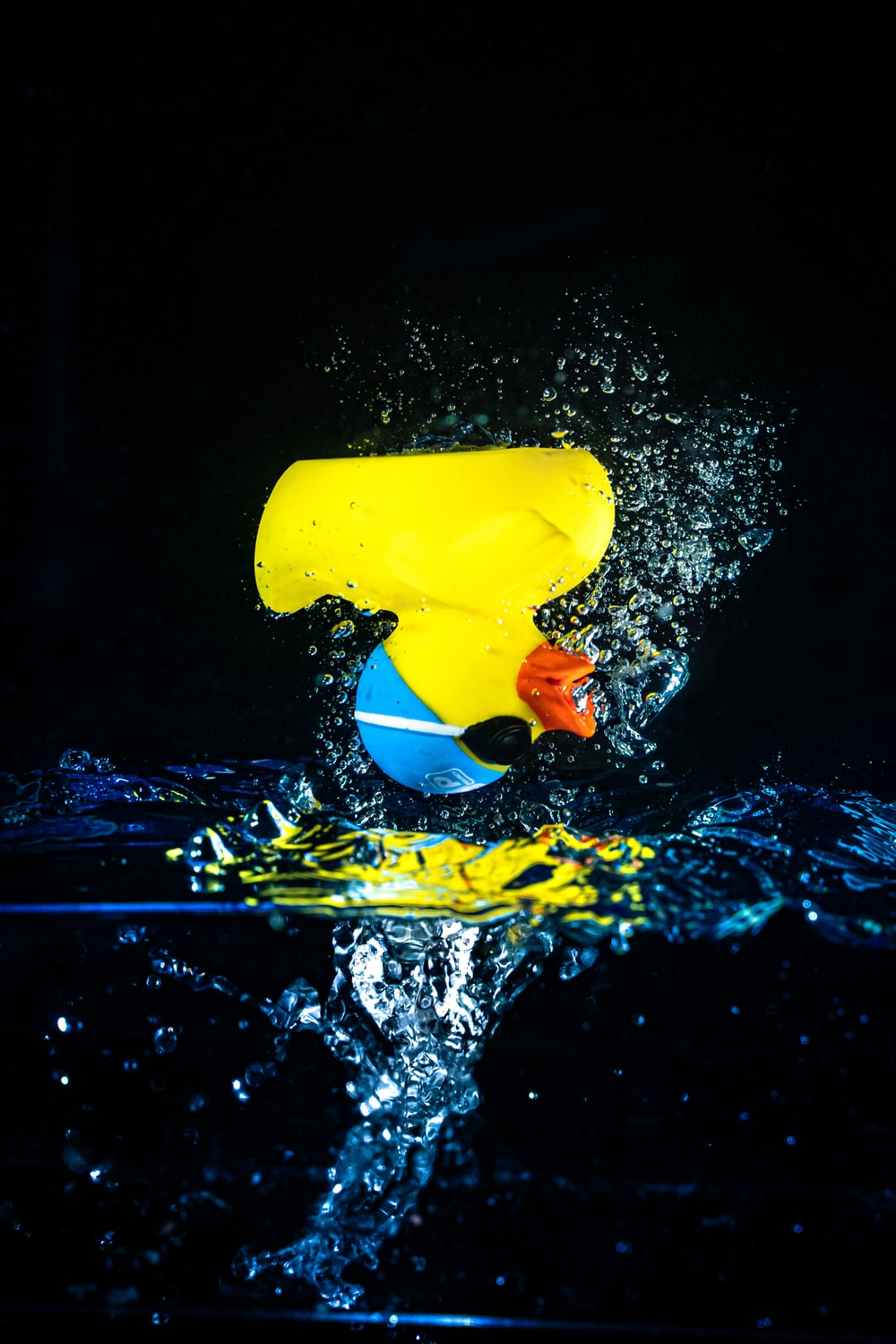 yellow plastic cup on water