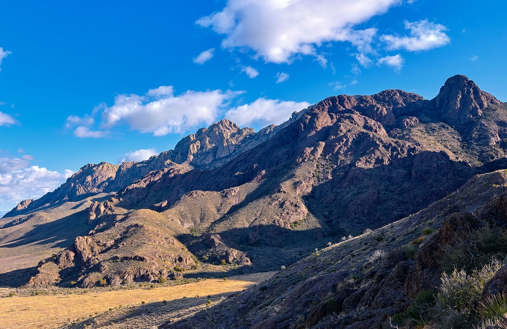 brown and gray mountains under blue sky during daytime
