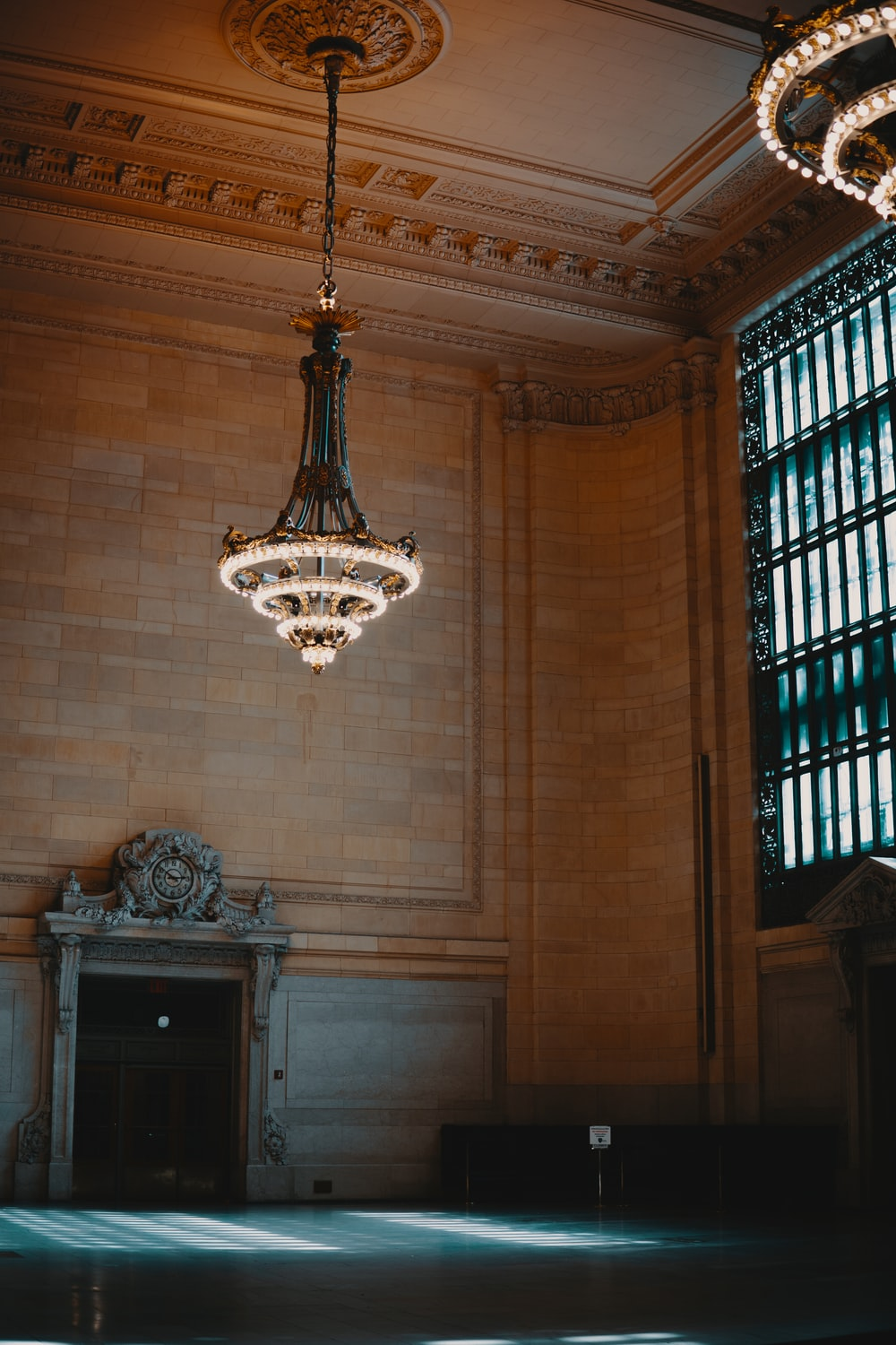 silver chandelier on brown ceiling