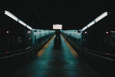 white train on train station during night time pandemic teams background