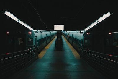 white train on train station during night time coronavirus zoom background