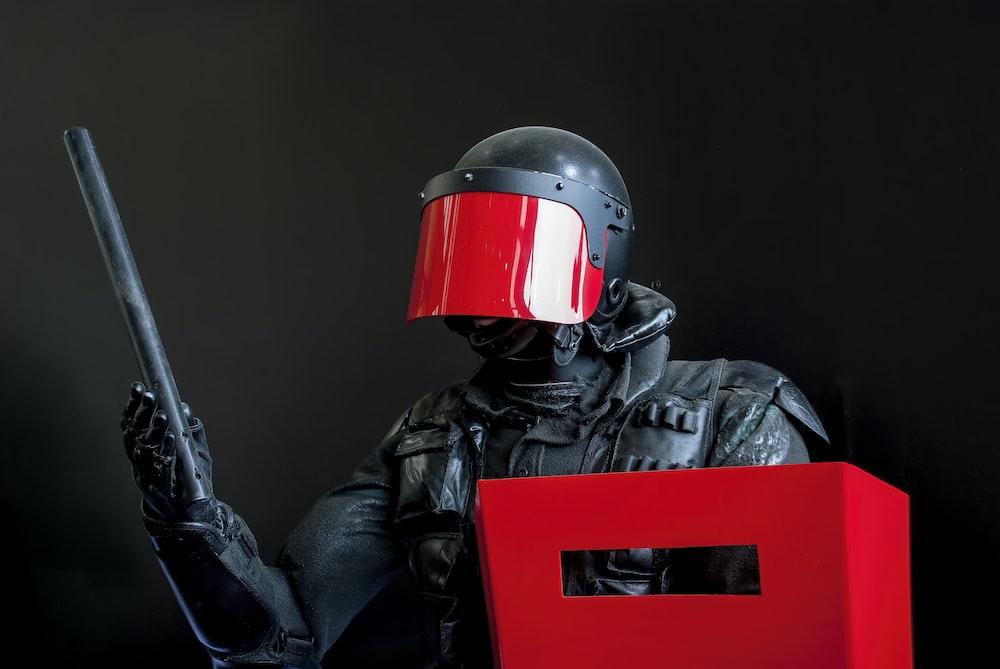 man in black leather jacket wearing red helmet