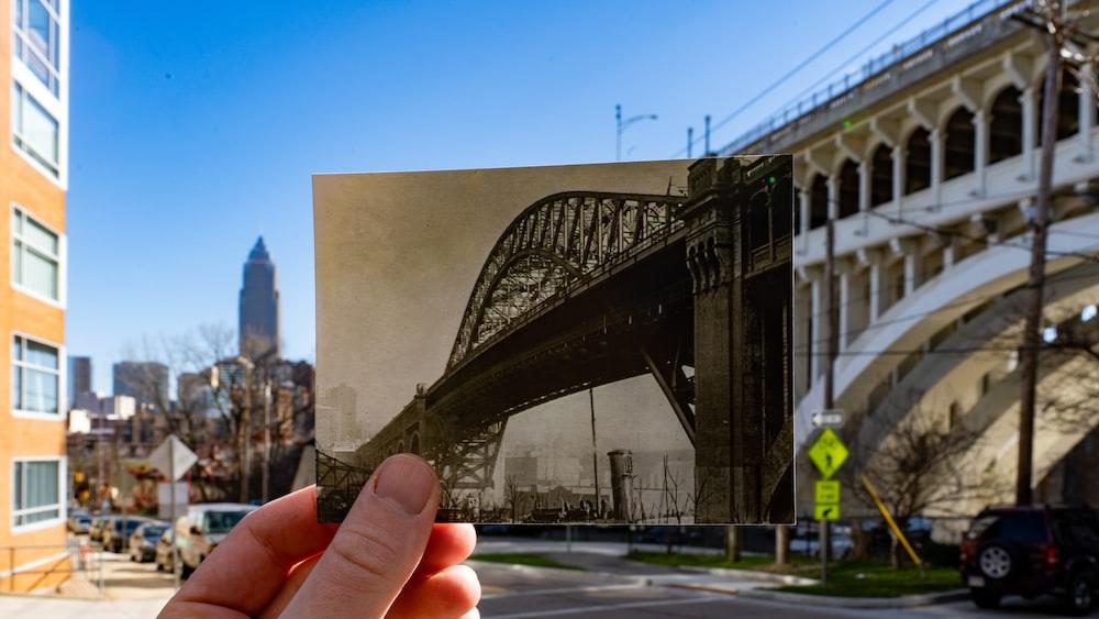 person holding photo of bridge