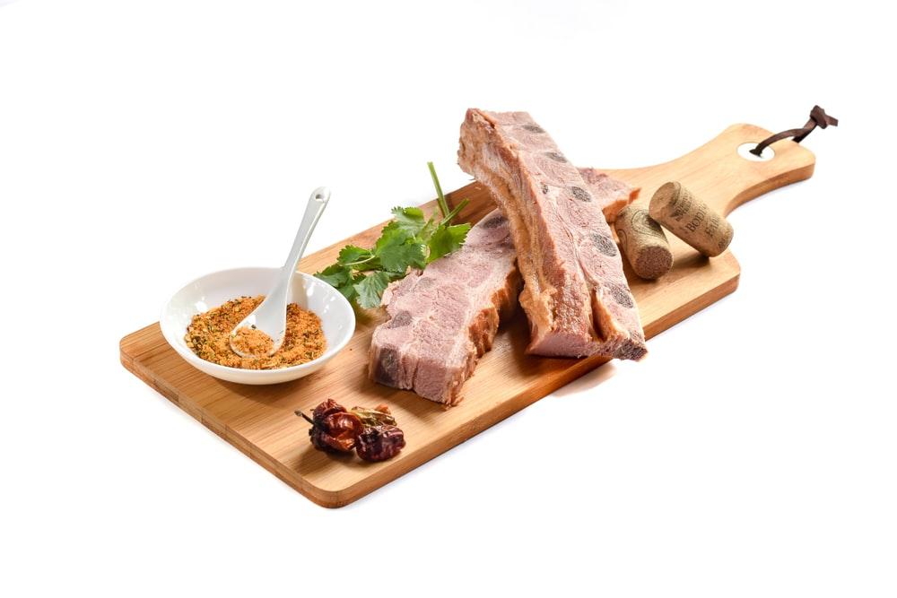 sliced meat on chopping board