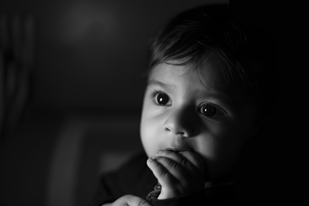 grayscale photo of childs face