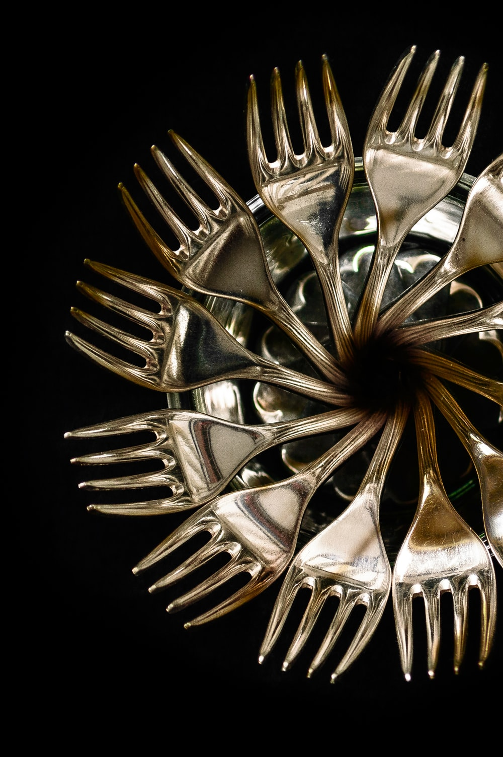 stainless steel fork lot in black background