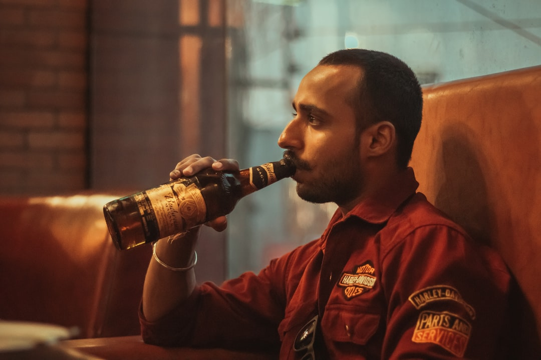 Boy drinking Beer in Bar