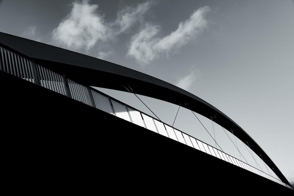 black and white bridge under blue sky