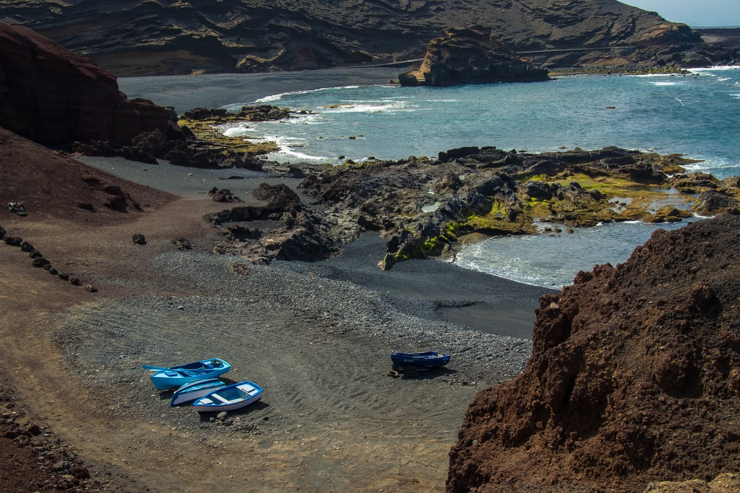 Three rowboat beached on one the the pebbled beaches near El Golfo, Lanzarote