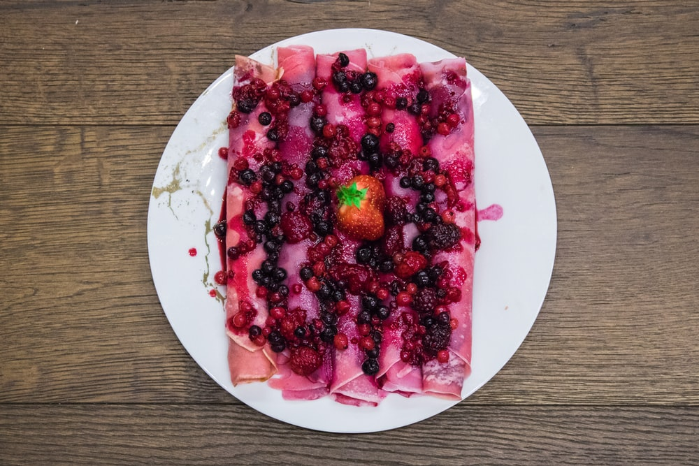 red fruit on white ceramic plate