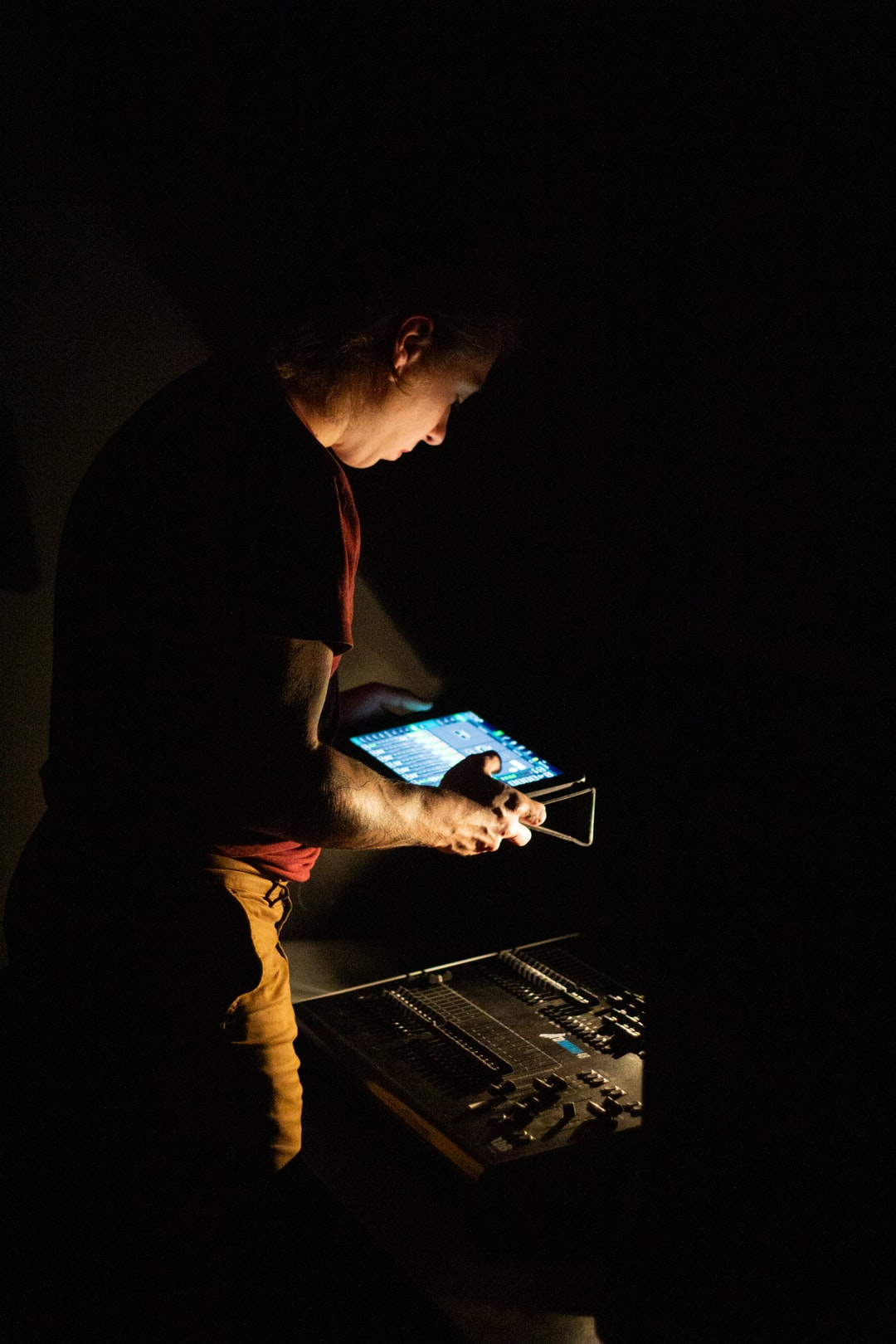 Man behind the settings table of a concert.