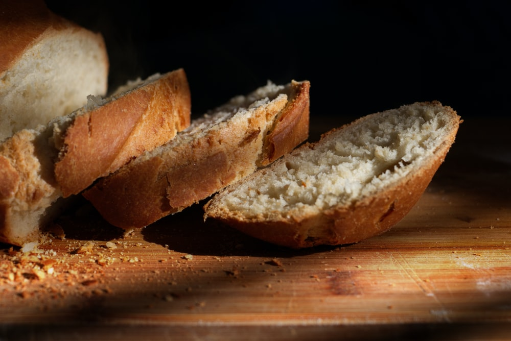 sliced bread on brown wooden table