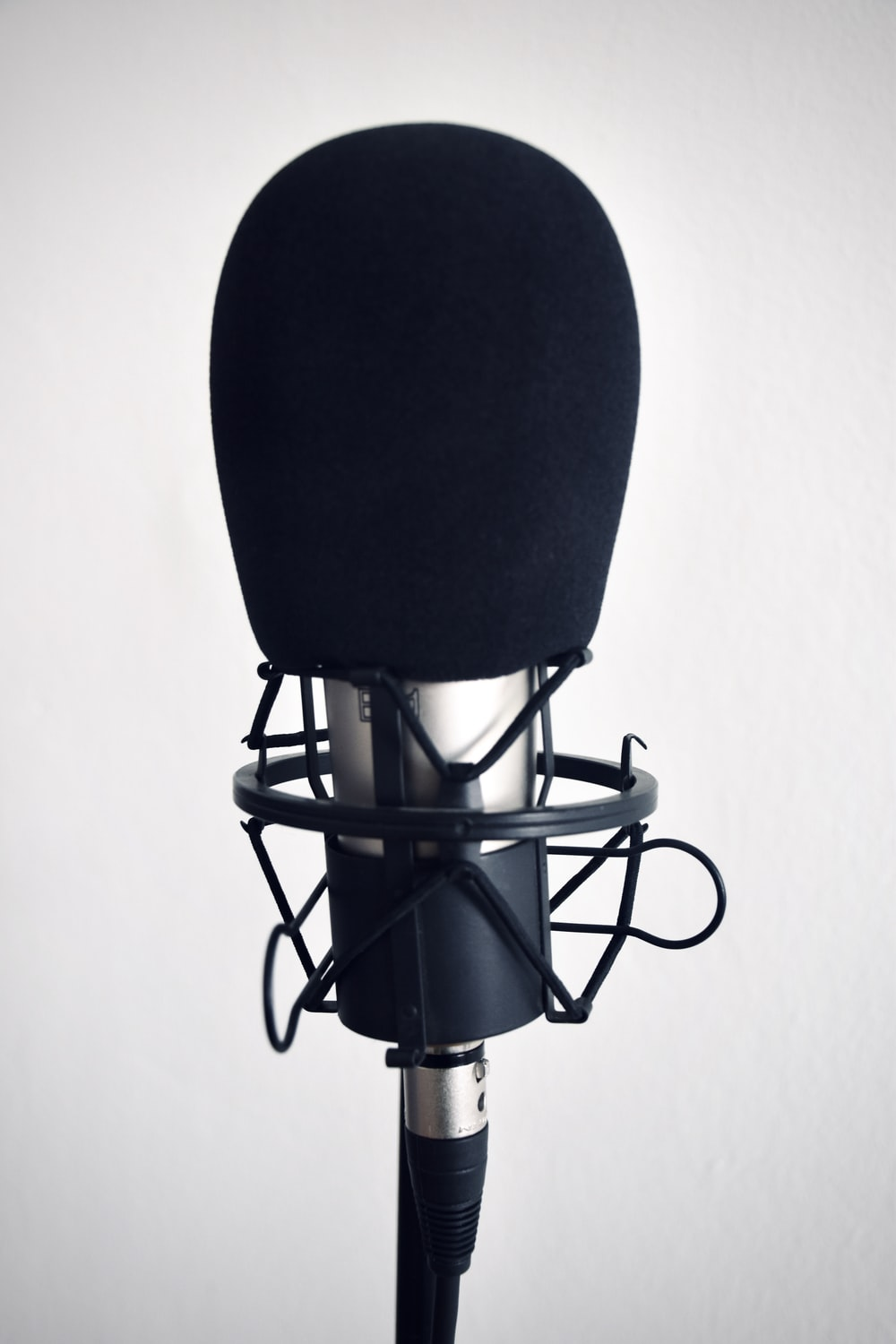 black and silver microphone on black stand