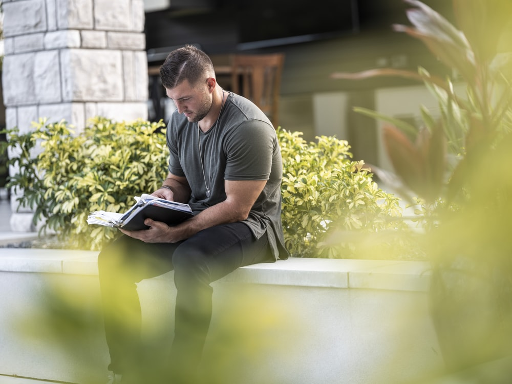 Tim Tebow reading a bible