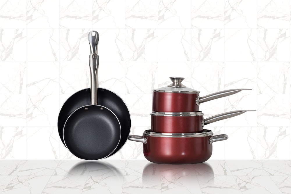 red and black cooking pots