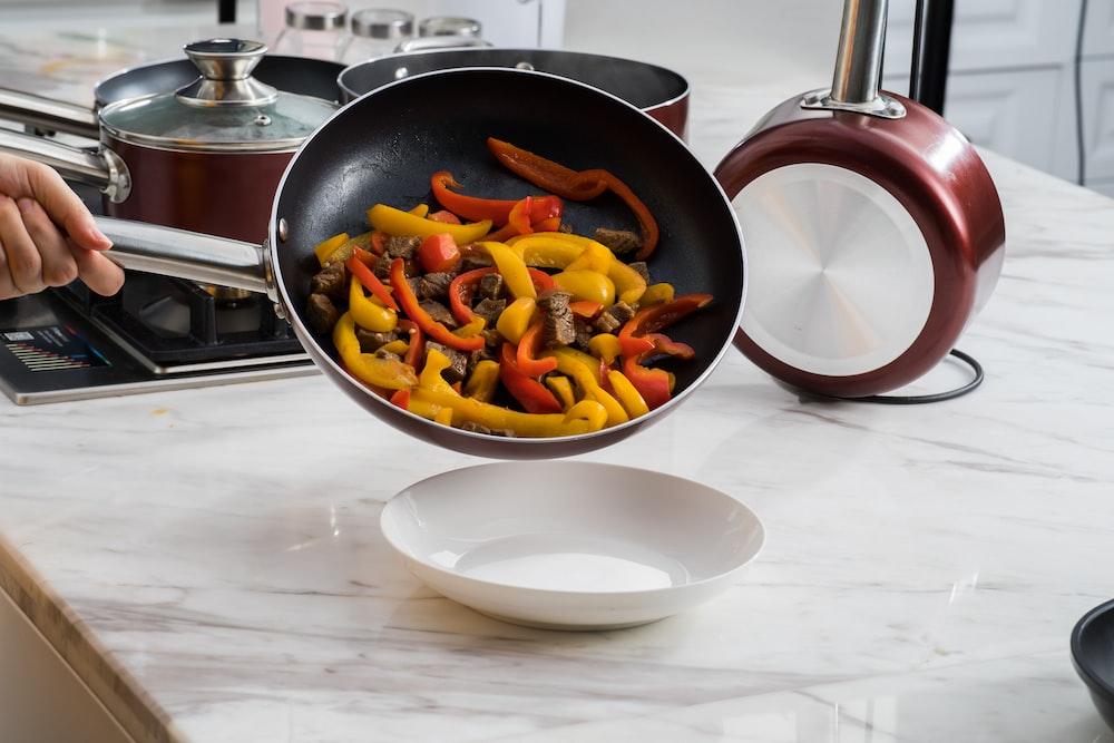 sliced fruits on black frying pan
