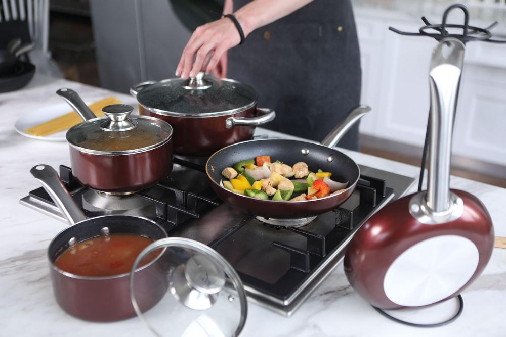 person cooking on stainless steel cooking pot