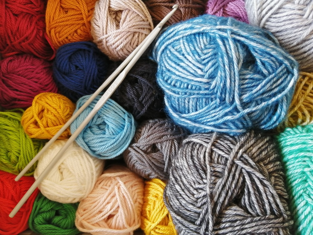 orange blue and white yarn