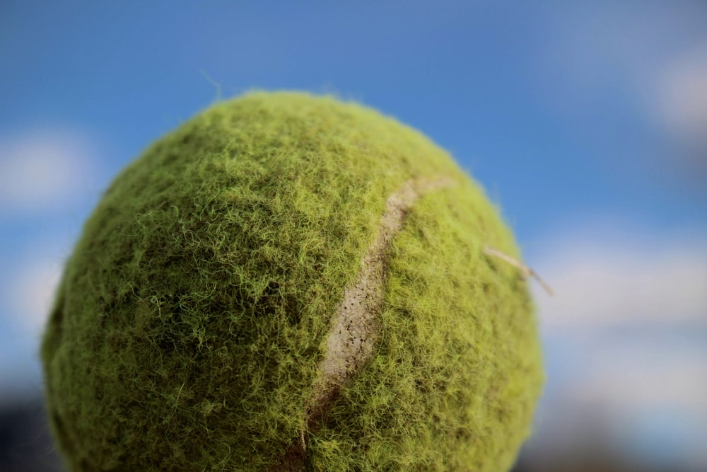 green tennis ball under blue sky during daytime