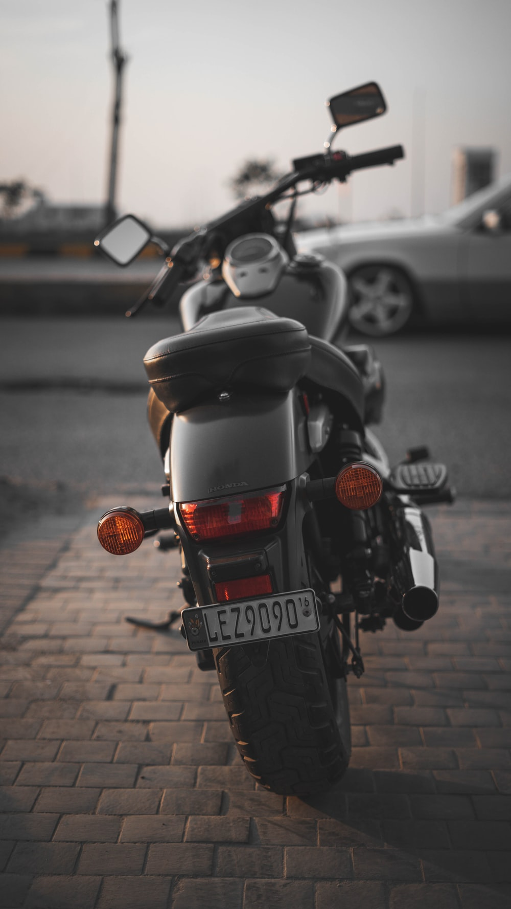 black and red motorcycle on road during daytime