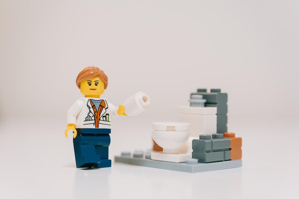lego mini figure on white table