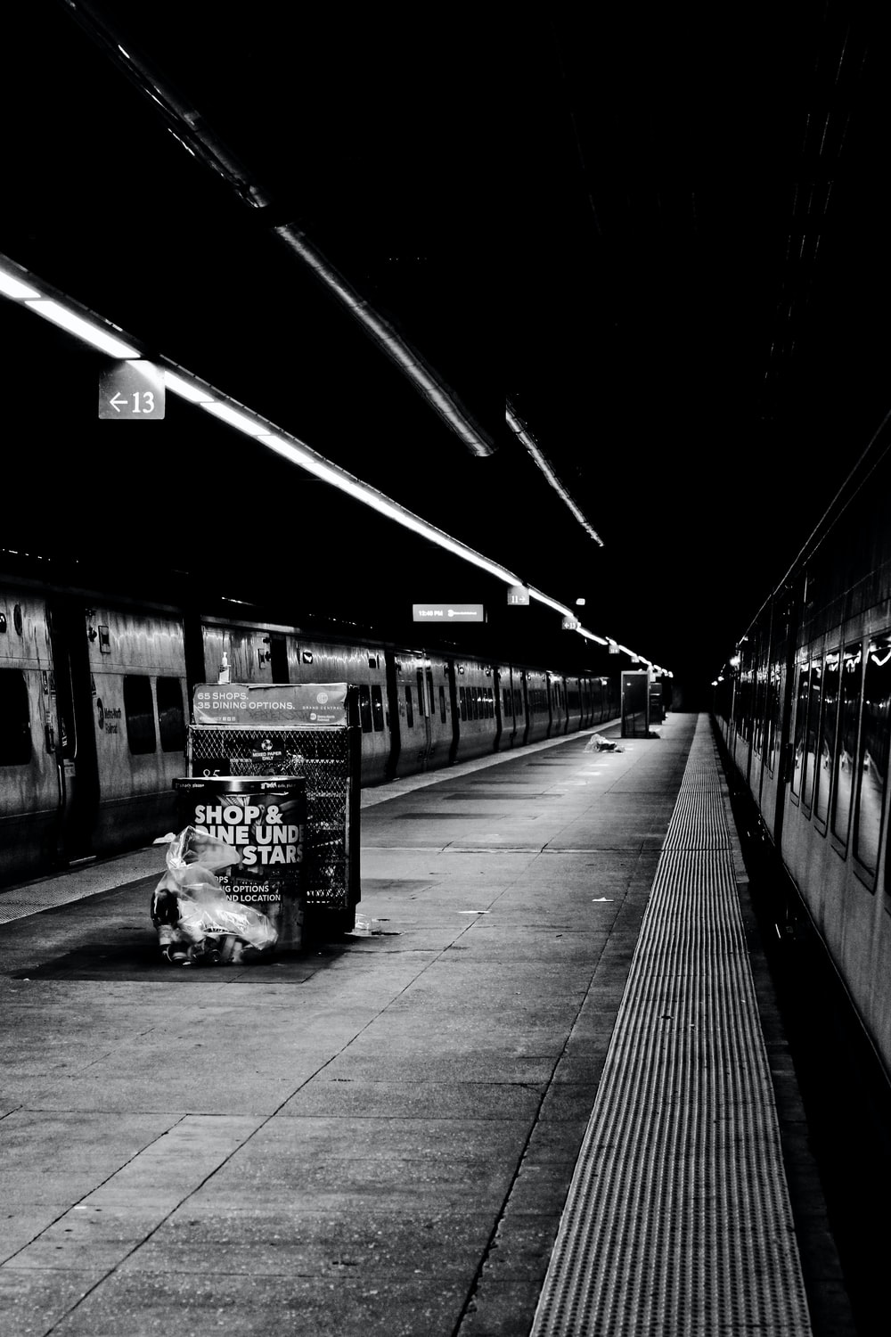 grayscale photo of a train station