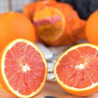 orange fruit on brown wooden table