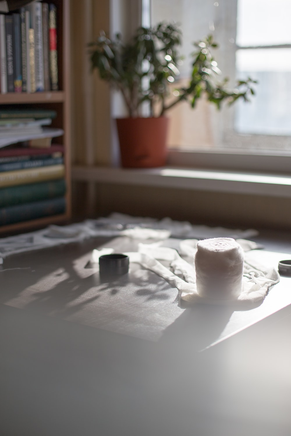 white ceramic cup on white table