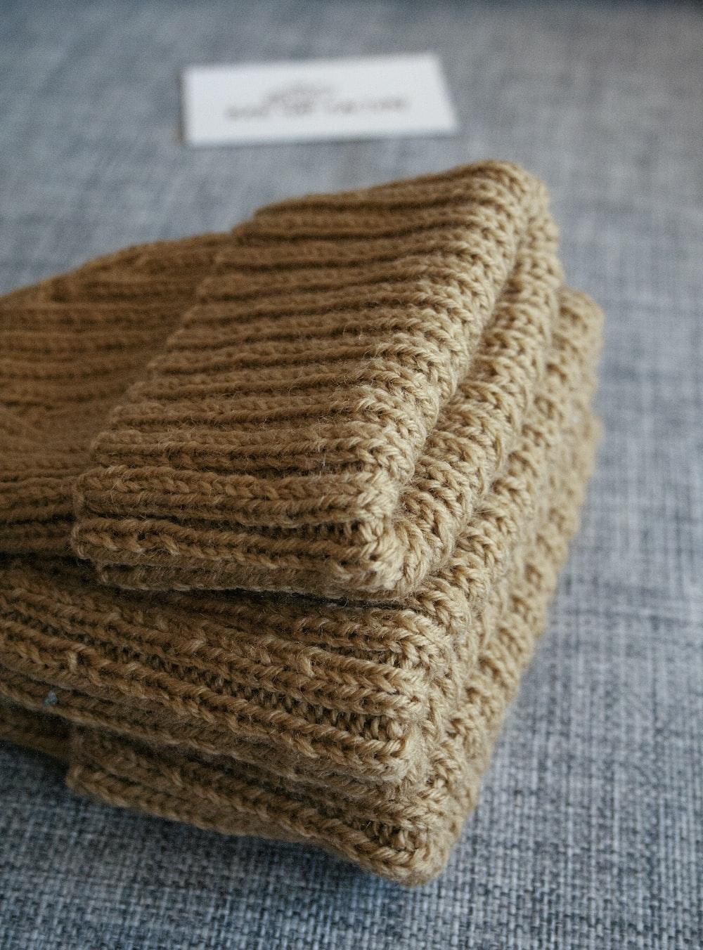 brown textile on gray textile