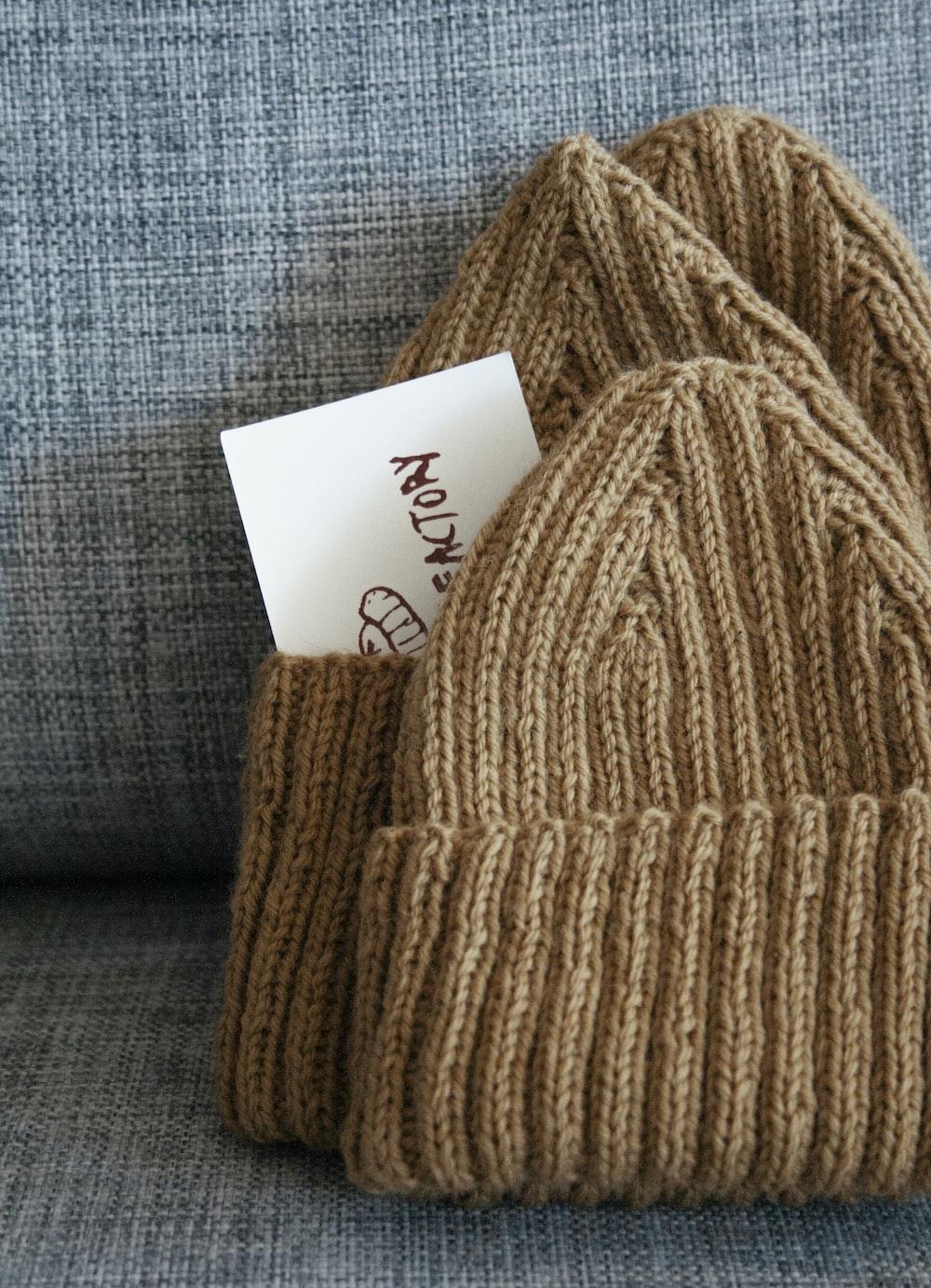 brown yarn on gray textile