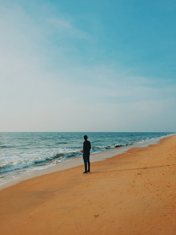 A guy standing in beach